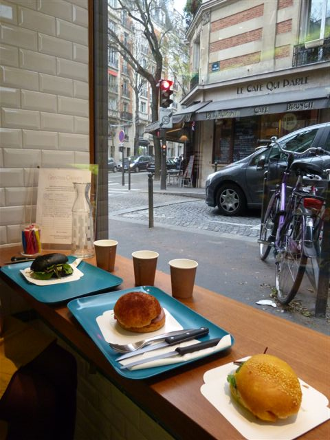 View out of window onto city streets, fresh bread in the foreground