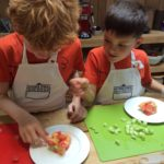 Children taking part in the Family Cooking class